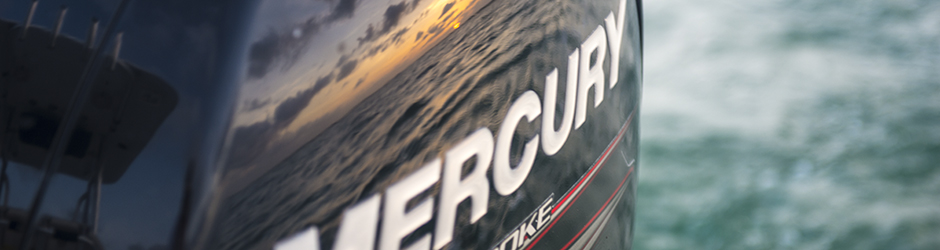 sunrise reflection off a Mercury 90 4 stroke outboard.